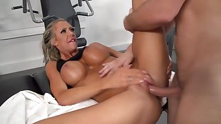 Milf with huge tits shagged by her gym trainer