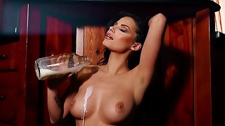 Brunette pours milf on boobs in a superb solo